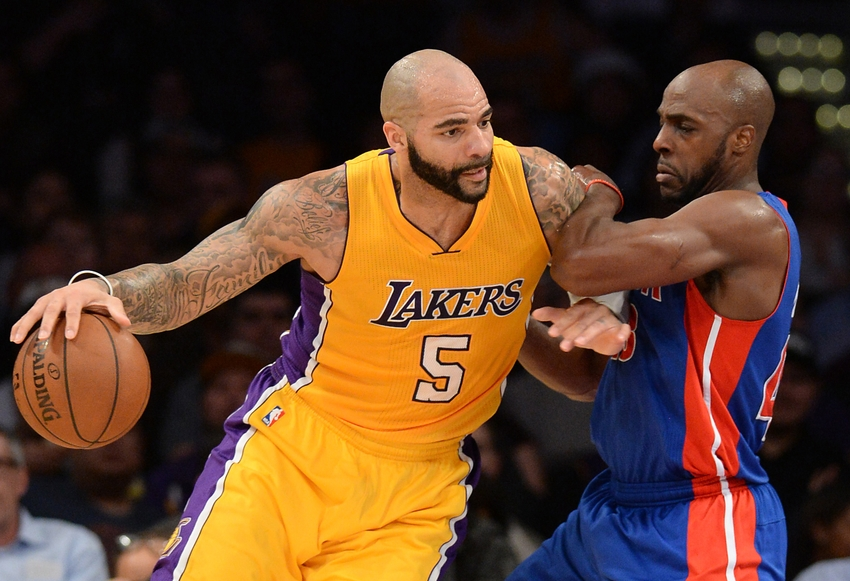 Mar 10, 2015; Los Angeles, CA, USA; Detroit Pistons forward Anthony Tolliver (43) guards Los Angeles Lakers forward Carlos Boozer (5) in the first half of the game at Staples Center. Mandatory Credit: Jayne Kamin-Oncea-USA TODAY Sports